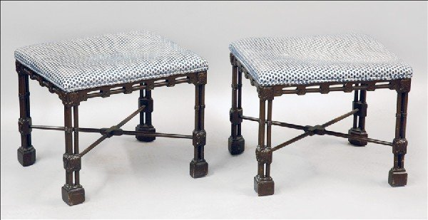 871006: PAIR OF CARVED AND UPHOLSTERED STOOLS.
