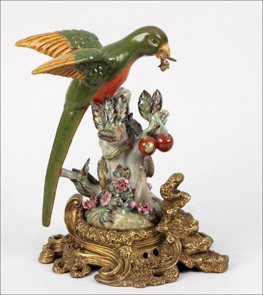 872111: PAINTED AND GLAZED CERAMIC FIGURE OF A PARROT.
