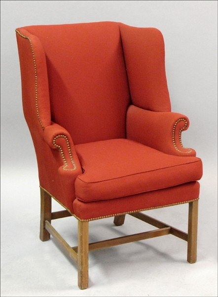 911018: UPHOLSTERED ARMCHAIR WITH NAILHEAD TRIM.