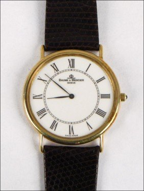 967007: BAUME & MERCIER 14 KARAT YELLOW GOLD WATCH.