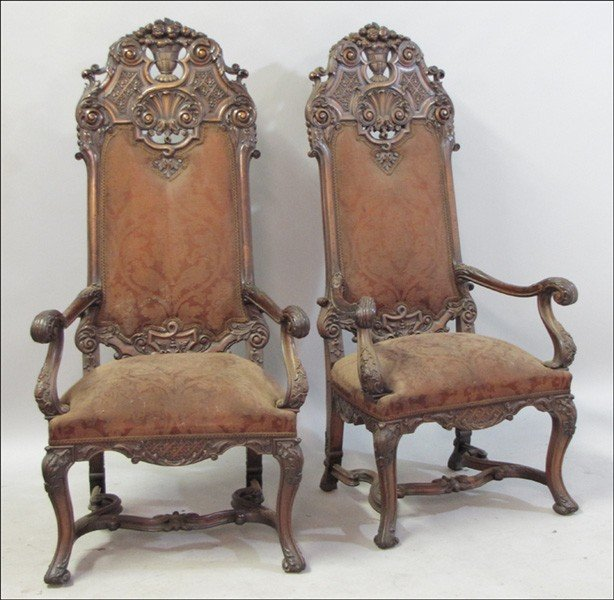 991019: PAIR OF CARVED MAHOGANY THRONE CHAIRS.