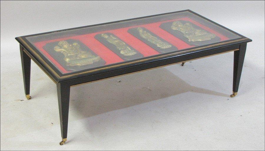 991020: PARCEL GILT EBONIZED WOOD COCKTAIL TABLE.