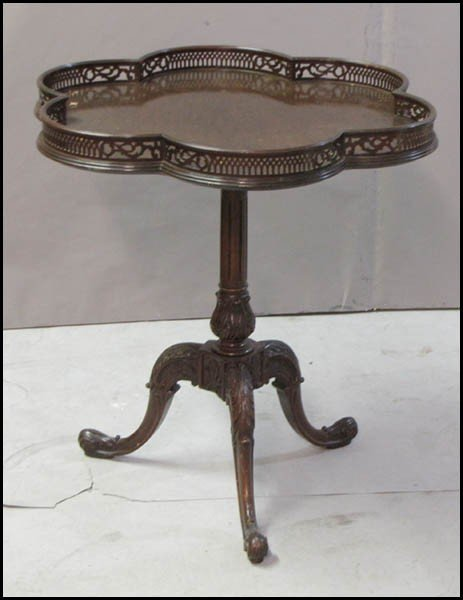991059: CHIPPENDALE STYLE MAHOGANY GALLERIED TABLE.
