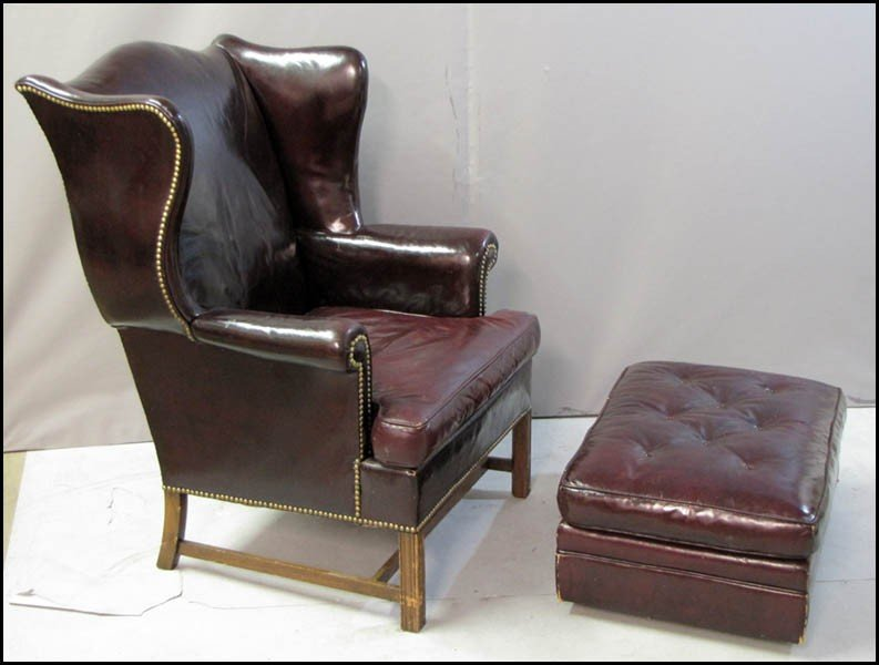 991060: KITTINGER LEATHER CHAIR AND OTTOMAN.