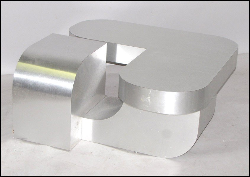 991067: CONTEMPORARY BRUSHED METAL COCKTAIL TABLE.