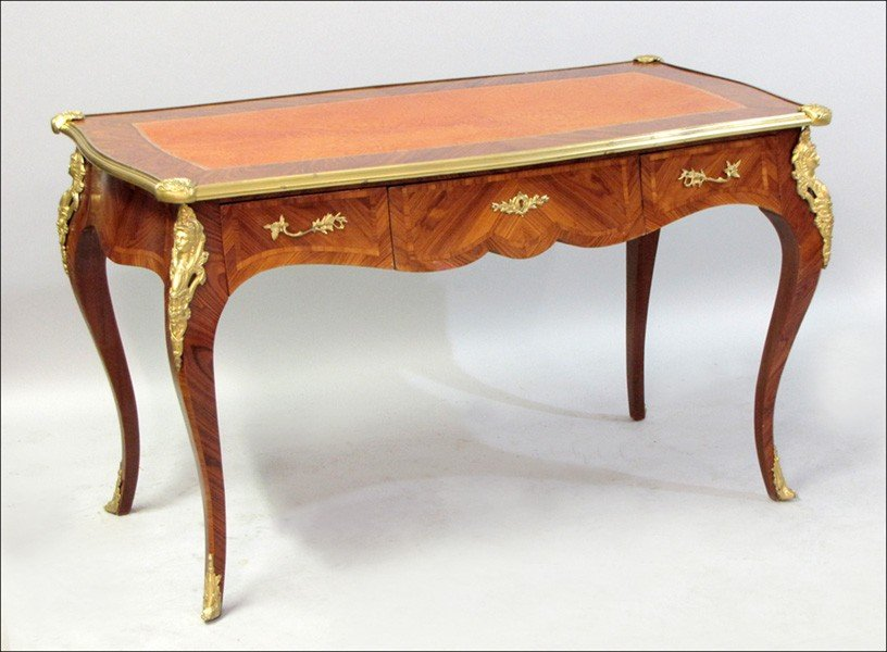 1011002: LOUIS XIV STYLE LEATHER-INSET AND ORMOLU MOUNT