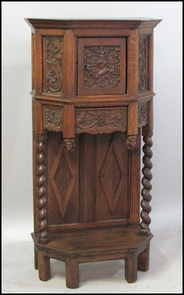 1031009: ENGLISH GOTHIC STYLE CARVED OAK CUPBOARD.
