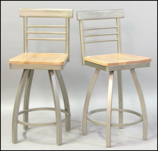 1041021: SET OF FOUR CONTEMPORARY MAPLE AND METAL SWIVE