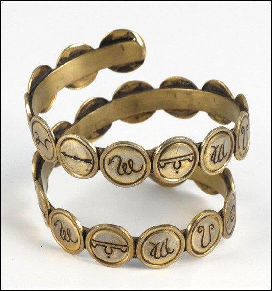 467015: CHANEL GILT METAL COIL BRACELET.