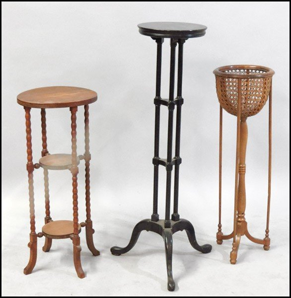 1061010: GROUP OF THREE PLANT STANDS.