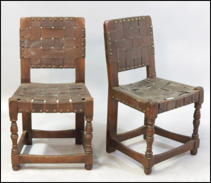 1061020: PAIR OF OAK AND LEATHER SIDE CHAIRS.