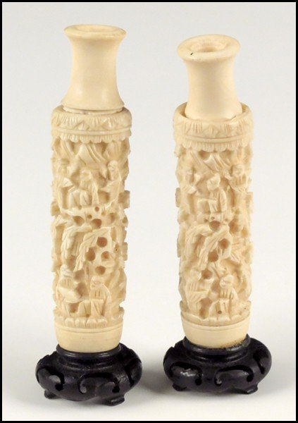 1073003: PAIR OF CARVED IVORY VASES.