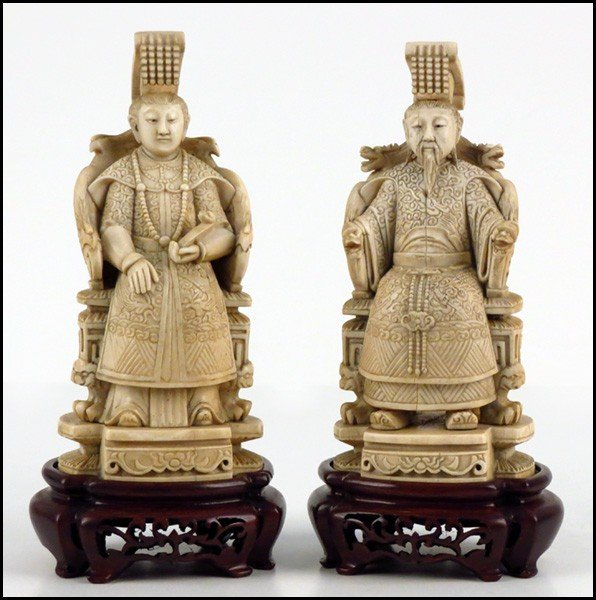 1073010: PAIR OF CARVED IVORY FIGURES OF A SEATED EMPER