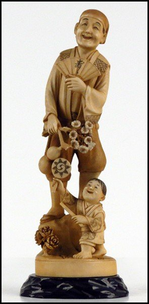 1073014: JAPANESE CARVED IVORY FIGURE OF A MAN WITH A F