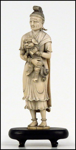 1073018: JAPANESE CARVED IVORY FIGURE OF A MAN AND A DO