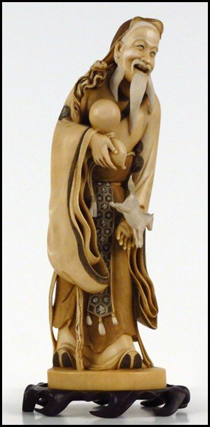 1073021: JAPANESE CARVED IVORY FIGURE OF A MAN WITHA GO