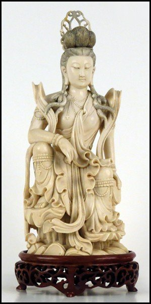1073023: CHINESE CARVED IVORY FIGURE OF A SEATED QUAN Y