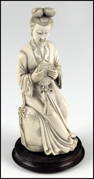1073024: CHINESE CARVED IVORY FIGURE OF A SEATED MUSICI