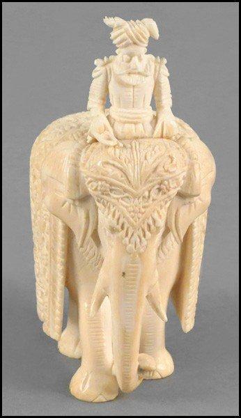 1073114: CHINESE CARVED IVORY ELEPHANT.