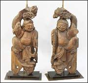 PAIR OF CHINESE CARVED WOOD FIGURES, FITTED AS