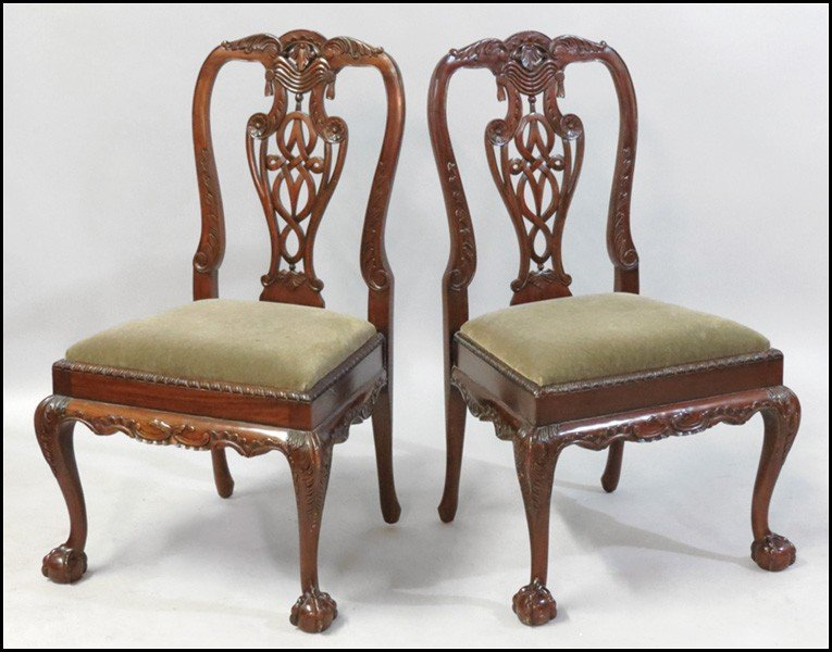 1081021: PAIR OF CARVED MAHOGANY SIDE CHAIRS.
