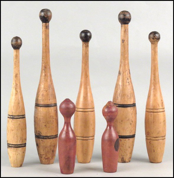 1082110: FIVE TURNED WOOD INDIAN CLUBS.