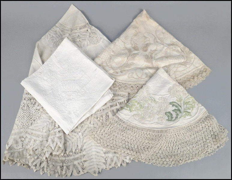 1085003: FOUR LACE AND EMBROIDERED TABLE LINENS.