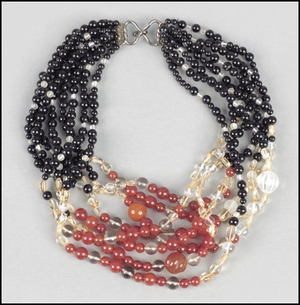 487011: KAI-YIN LO MULTI-STRAND NECKLACE.