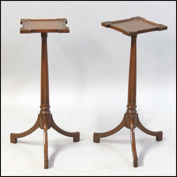 1101003: PAIR OF CARVED MAHOGANY CANDLESTANDS.