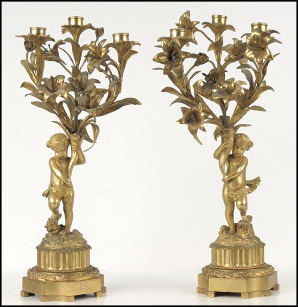 1112006: PAIR OF CONTINENTAL GILT BRONZE THRE-LIGHT CAN