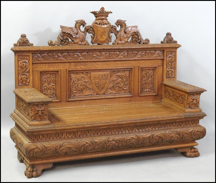 1121020: CONTINENTAL CARVED OAK HALL BENCH.