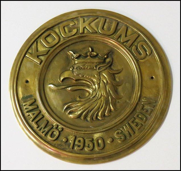 1122215: ROUND BRASS SHIPBUILDER'S PLAQUE FOR KOCKUMS M