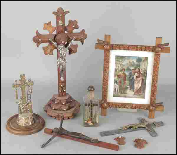 A COLLECTION OF FIVE CRUCIFIXES.