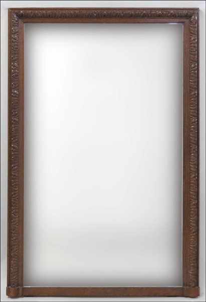 1131004: CONTINENTAL CARVED OAK MIRROR.