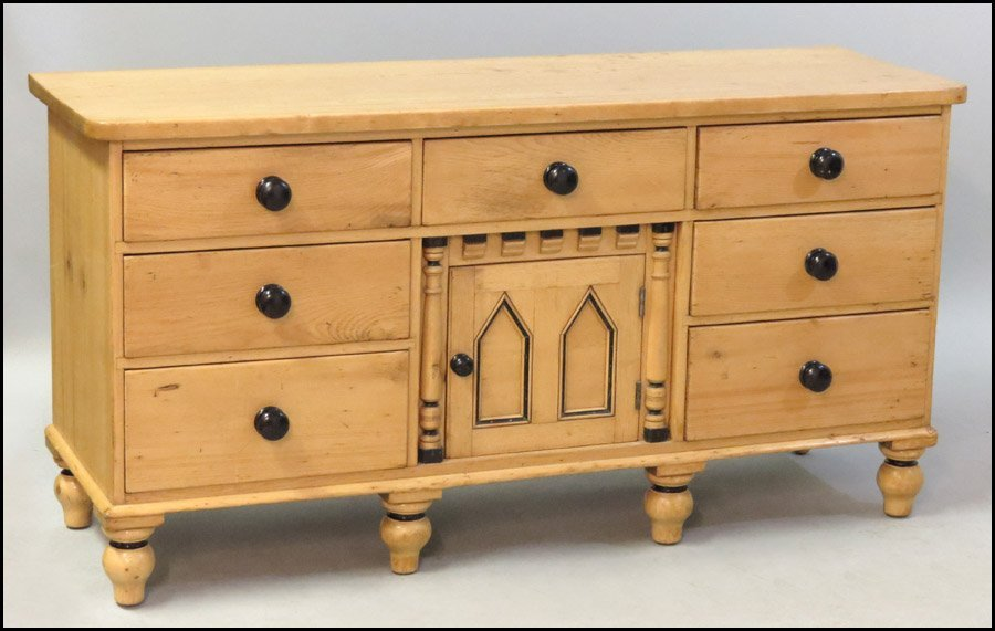 1131010: CARVED AND PAINTED PINE SEVEN DRAWER DRESSER.
