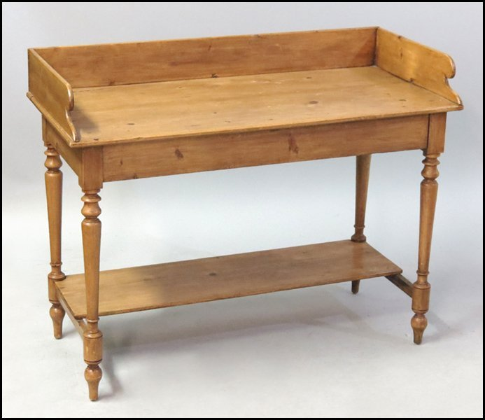 1131011: CARVED PINE WASH STAND.