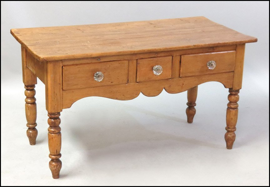 1131013: PINE THREE DRAWER TABLE.
