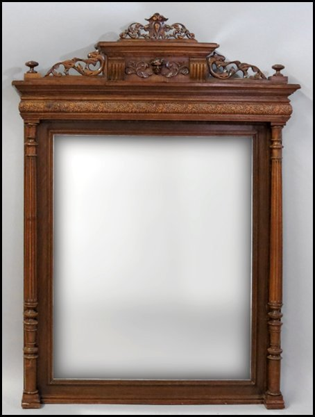 1131015: CONTINENTAL CARVED OAK MIRROR.