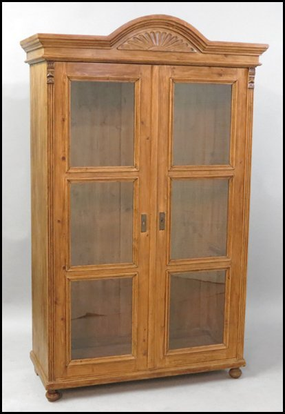 1131022: CONTINENTAL CARVED WALNUT TWO DOOR CABINET.