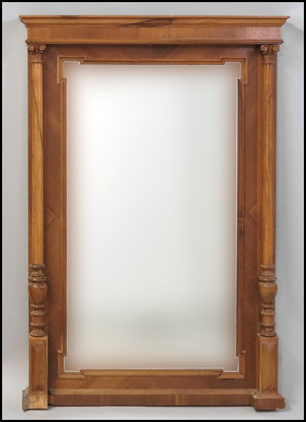 1131024: CONTINENTAL CARVED OAK MIRROR.