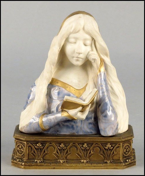 1142021: FRENCH GILT AND PAINTED PORCELAIN BUST.