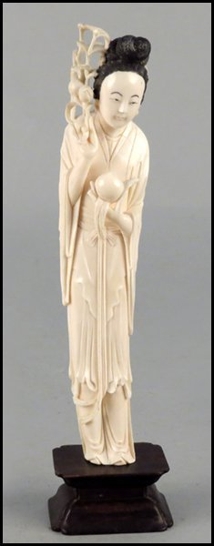 1143008: CARVED IVORY FIGURE OF A MAIDEN HOLDING FRUITS