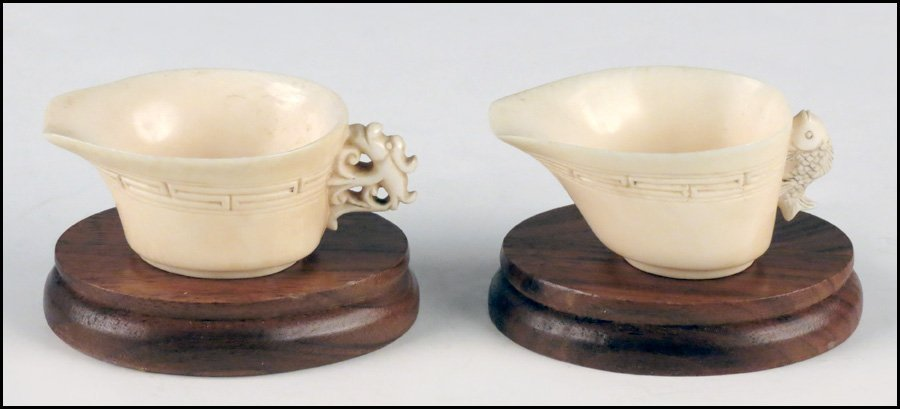 1143010: TWO CARVED IVORY HANDLED CUPS.
