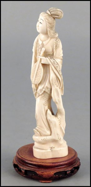 1143011: CARVED IVORY FIGURE OF A MAIDEN WITH AN INSTRU