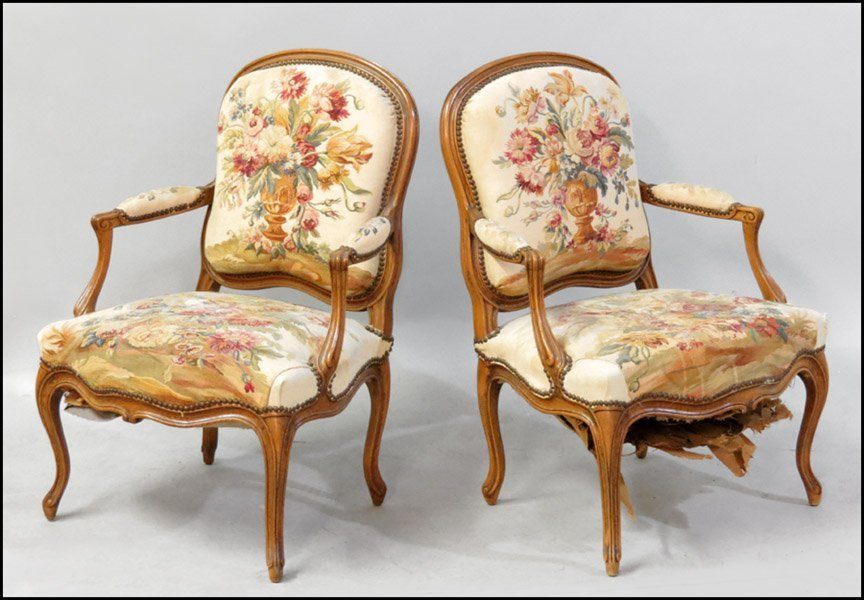 1151013: PAIR OF FRENCH CARVED WALNUT FAUTEUIL.