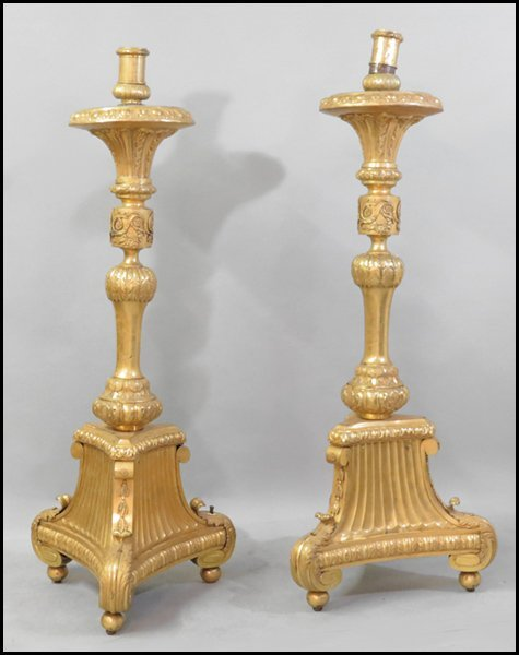 1151023: PAIR OF FRENCH GILT COPPER TORCHIERES.