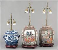 1173069 PAIR OF CHINESE PORCELAIN COVERED JARS FITTED