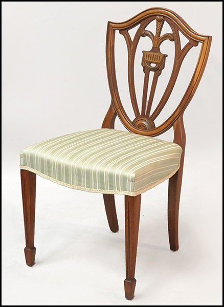 SET OF FOUR HEPPLEWHITE STYLE FRUITWOOD SIDE CHAIRS.