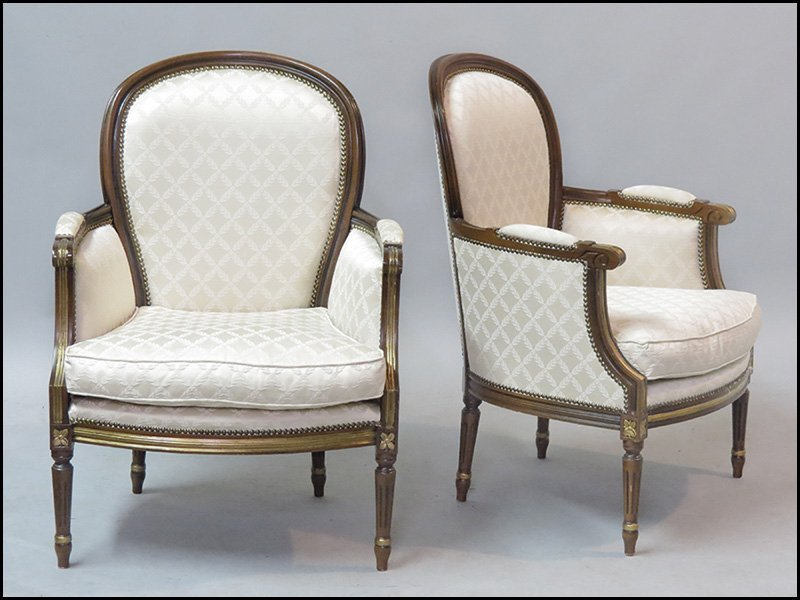 PAIR OF FRENCH CARVED MAHOGANY AND PARCEL GILT FAUTEUIL
