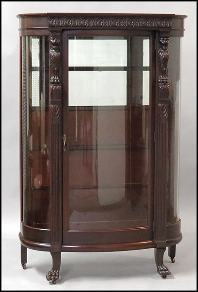 CONTINENTAL CARVED OAK VITRINE.